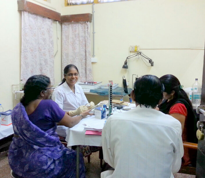 Dr. Amole Ade  with patients